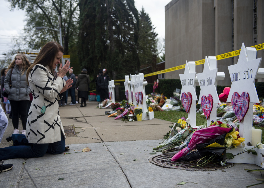 A woman seen praying at the memorial service for the victims of the Tree of Life Massacre. Members of Pittsburgh and the Squirrel Hill community pay their respects at the memorial to the 11 victims of the Tree of Life Synagogue massacre perpetrated by suspect Robert Bowers on Saturday, October 27.