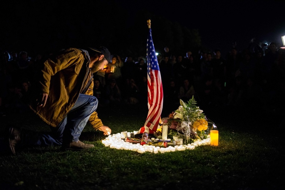 People seen paying tribute at the monument for the victims during the vigil. Thousands showed up at city hall for the Vigil honoring victims and their families of the Thousand Oaks Borderline Shooting.