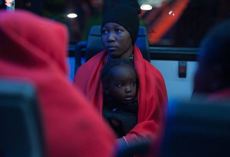 A migrant woman with her son is seen sitting inside a bus after her arrival at the Port of Malaga. Spain's Maritime Rescue service rescued 262 migrants aboard  dinghies at the Alboran Sea and brought them to Malaga harbour where they were assisted by the Spanish Red Cross. A total of 564 migrants were rescued and 3 corpses find in this Wednesday by the Spain's Maritime Rescue service.