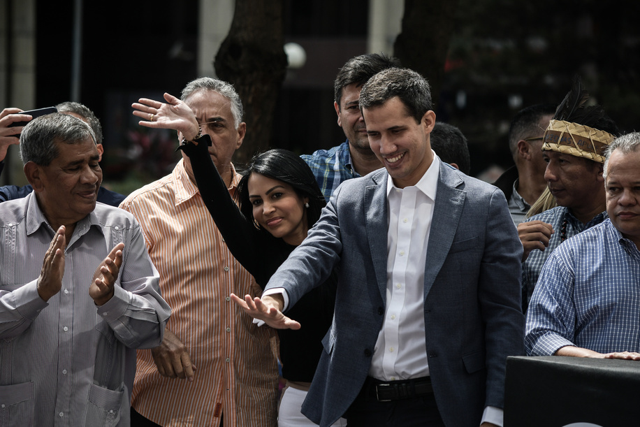 President of the National Congress, Juan Guaido, greets the people during a public demonstration held in Caracas. Maduro was elected for a second term following the 2018 election, followed by international criticism that his leadership of the country suffering a hyperinflationary collapse is misbegotten. The opposition, the 'National Assembly' bets for a transition government.