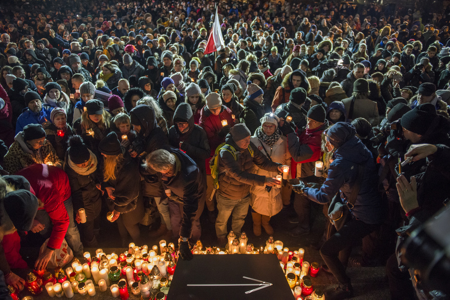 People seen lightning candles in memory of the mayor Pawel Adamowicz. Pawel Adamowicz, the mayor of the Polish city of Gdansk died after being stabbed several times on stage during the Great Orchestra of Christmas Charity, Poland's most important charity on Sunday evening.