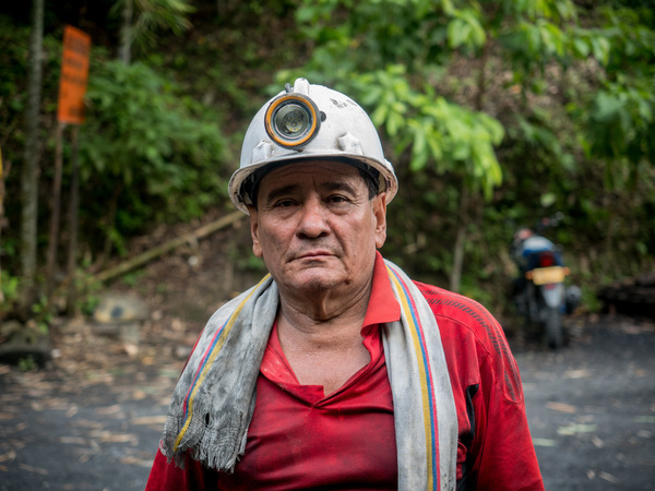 """Miner after his shift in the legal mine Dubai. The biggest and best quality emeralds are mined in remote Muzo valley in Colombia, world number 1 depository of emeralds. Besides legal mines, people try to find emerald in debris from mining excavations. People searching for emeralds are called barequeros. Some of them are succesfull, some of them are desperate. Those with """"emerald fever"""" are not able to leave the valley even if they don´t have anything to eat. They became emerald addicted. Emerald trade is running directly in the illegal mine or in the streets of the town Muzo. Emerald traders transport the gems with helicopters or with small planes from the remote valley."""