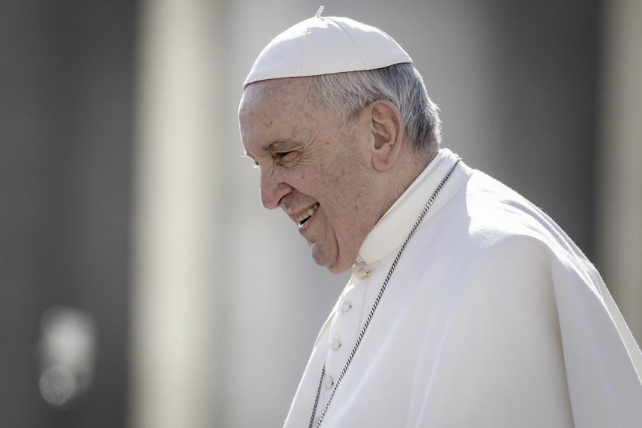 Pope Francis smiles as he arrives to lead the weekly General Audience at St. Peter's Square. The General Audience is held every Wednesday, when the Pope is in Vatican at Saint Peter's Square, which can accommodate around 80,000 people. During the General Audience, also called Papal Audience, the Holy Father addresses the crowd in different languages.