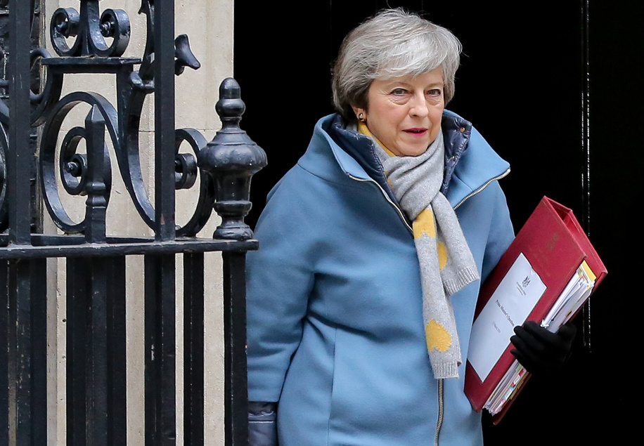 British Prime Minister Theresa May is seen departing from Number 10 Downing Street to attend Prime Minister's Questions (PMQs) in the House of Commons.