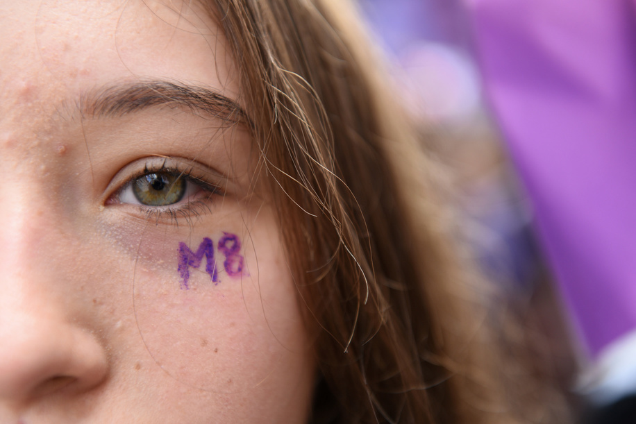 A girl seen with an M8 close to her eye during the protest. Thousands of women march in Madrid in defence of their rights and to demand end to violence against women, to racism and to xenophobia.  Spain celebrates International Women's Day with a women's general strike and countless protests around the country.