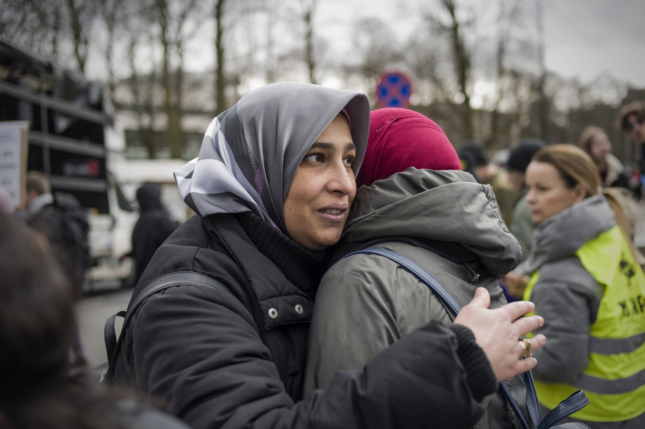Muslims women seen hugging themselves during the Anti Racism Day Strike in Warsaw. Hundreds of people have joined a march against the rise of racism, far right and fascism in Warsaw. The demonstration was a part of the global Anti-Racism Day.