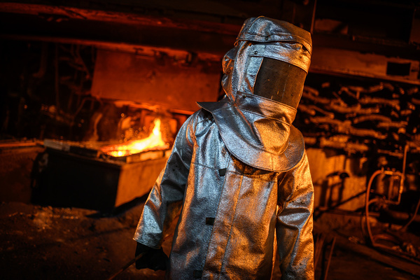 A worker in a fire suit seen supervising the flow of hot liquid metal as it flows from a furnace at the plant. Production of matte nickel at the PT Vale nickel plant, in Sorowako, South sulawesi, Indonesia, the plant is targeting a production of 75,000 metric tons in 2019.