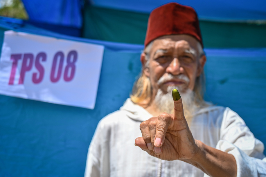 An Indonesian voter seen showing his inked finger after voting during the general elections. More than 192 million Indonesians elect their president and vice president as well as members of the House of Representatives, Regional Representative Council and provincial and municipal councils.
