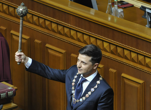 New Ukrainian president Volodymyr Zelensky seen holding a  mace, Ukrainian symbol of power during his inauguration ceremony at the Ukrainian parliament.