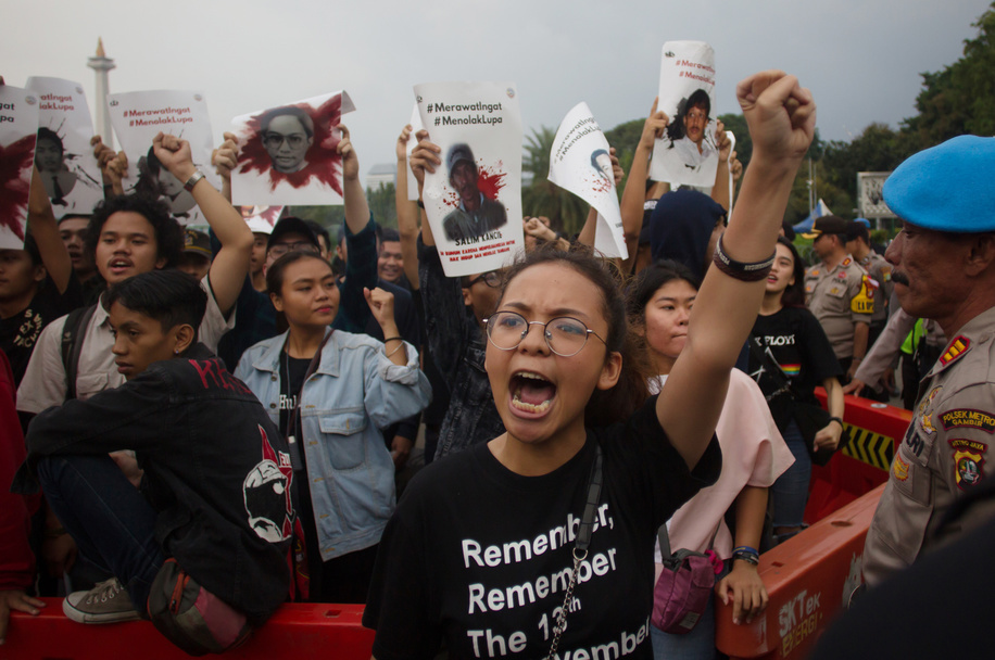 A woman seen shouting during the protest. The Victim Solidarity Network for Justice (JSKK) held a silent protest in front of the Presidential Palace in Jakarta. The act is commonly known as Aksi Kamisan and this was its 586th day and the demand is for the President to resolve human rights violations in the May 1998 Tragedy: Trisakti - Semanggi I - Semanggi II and May 13-15 1998 Riots.