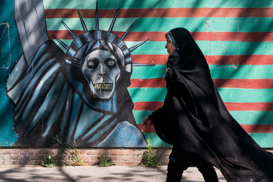 A woman seen passing by a famous anti American graffiti at the former American embassy in Tehran, a main stage of the hostage crisis that ended diplomatic relations between Iran and the US. Iran is a society, that after a time of repression, is slowly opening despite still being seen as a threat to the west.