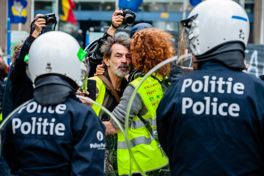 A yellow vest couple is seen hugging in front of the riot police during the protest. Hundreds of yellow vests from different parts of Europe protested against the EU parliament during the EU elections, at the Brussels North station. The riot police showed up and clashed with the demonstrators.