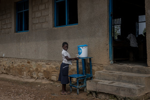 A Child washes her hands with chlorinated water at a primary school as part of a preventive initiative aimed at halting the spread of Ebola in Beni. The DRC is currently experiencing the second largest Ebola outbreak in recorded history, and the response is hampered by it being in an active conflict zone. More than 1,400 people have died since August 2018.