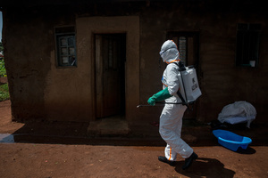 World Health Organization worker Belinda Landu, 28, decontaminates the house of a pastor who has just tested positive for Ebola in Beni. The DRC is currently experiencing the second largest Ebola outbreak in recorded history, and the response is hampered by it being in an active conflict zone. More than 1,400 people have died since August 2018.