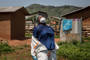 World Health Organization worker Belinda Landu, 28, changes her protective outfit after decontaminating the house of a pastor who has just tested positive for Ebola in Beni. The DRC is currently experiencing the second largest Ebola outbreak in recorded history, and the response is hampered by it being in an active conflict zone. More than 1,400 people have died since August 2018.
