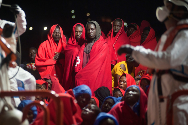 A group of migrants stand on a rescue vessel as they wait to disembark after their arrival at the Port of Malaga. Spain's Maritime Rescue service rescued a total of 174 migrants (of them, 35 women and 7 children) aboard three dinghies crossing the Alboran Sea and brought them to Malaga harbour, where they were assisted by the Spanish Red Cross.
