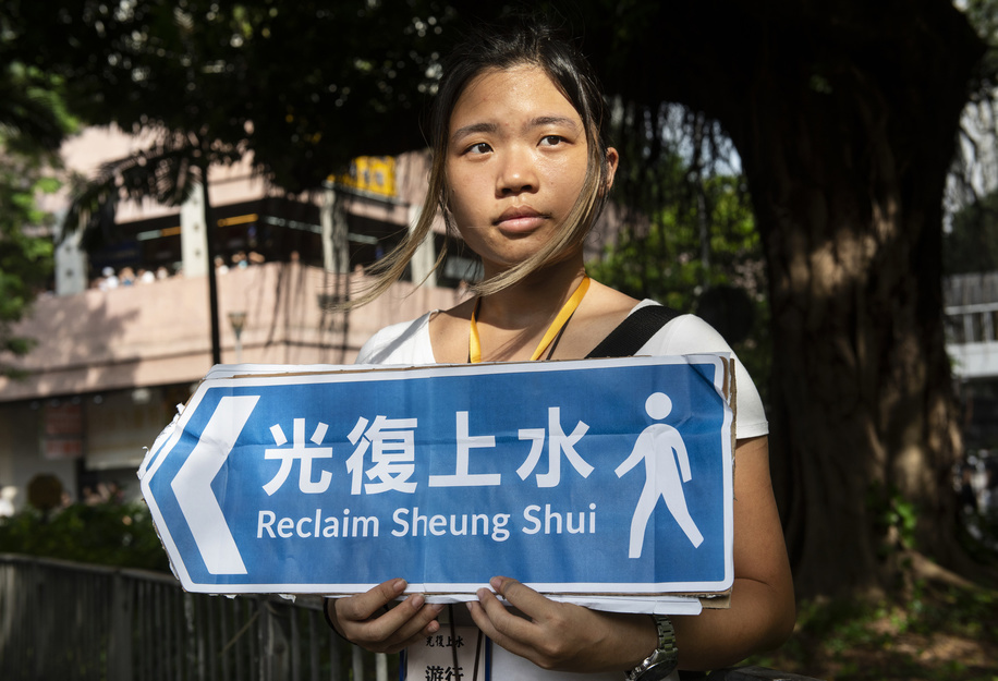 A protester holds an Anti parallel trading placard during the march. Thousands of protesters took to the streets of the Sheung Shui district in northern Hong Kong in an anti-parallel trading march. Some protesters clashed with the police after the march. Numbers of protesters are reported to be injured.
