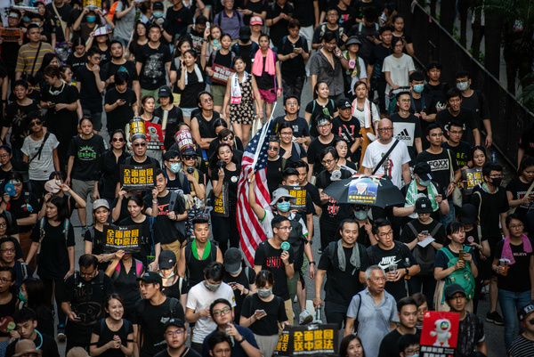 Protesters hold placards and banners during the demonstration. Tens of thousands of protesters took to the street of Hong Kong in yet another weekend of anti government rally. They demand the total withdrawal of  of the extradition bill.