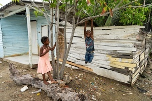 Children have fun at the La Boquilla during a clean-up session in Cartagena. Fundacion CoraJeM works in educating and creating opportunities for the people in need. Teaching them culture and values, it allows them to build up a better future and live with more dignity.