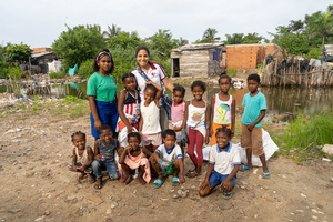 Organiser Eugenia Assaf with children pose for a photo at the La Boquilla during a clean-up session in Cartagena. Fundacion CoraJeM works in educating and creating opportunities for the people in need. Teaching them culture and values, it allows them to build up a better future and live with more dignity.