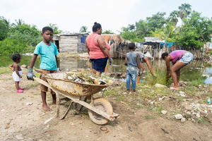 A young boy carries a wheelbarrow at the La Boquilla during a clean-up session in Cartagena. Fundacion CoraJeM works in educating and creating opportunities for the people in need. Teaching them culture and values, it allows them to build up a better future and live with more dignity.