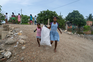 Kids carry a sack of plastic waste at the La Boquilla during a clean-up session in Cartagena. Fundacion CoraJeM works in educating and creating opportunities for the people in need. Teaching them culture and values, it allows them to build up a better future and live with more dignity.