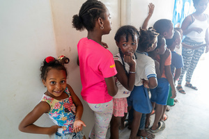 Children in a queue to receive gifts at the La Boquilla after the clean-up session in Cartagena. Fundacion CoraJeM works in educating and creating opportunities for the people in need. Teaching them culture and values, it allows them to build up a better future and live with more dignity.