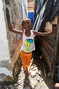A young kid poses for a photo at the La Boquilla during a clean-up session in Cartagena. Fundacion CoraJeM works in educating and creating opportunities for the people in need. Teaching them culture and values, it allows them to build up a better future and live with more dignity.