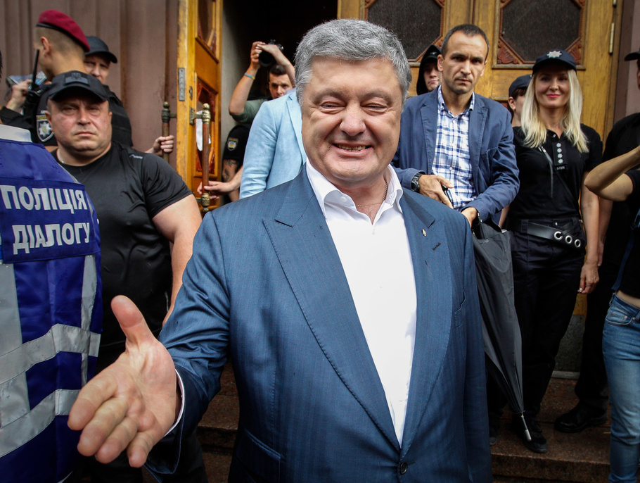 Former Ukrainian President Petro Poroshenko leaves after his interrogation at the State Investigations Bureau in Kiev.Petro Poroshenko, the fifth President of Ukraine, was interrogated at the State Investigations Bureau on the case of possible illegal actions during the purchase and sale procedure of Kuznya na Rybalskomu factory, as local media reported.
