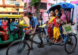Little kids seen dressed up as Lord krishna seen in a hand pull Rickshaw during the Janmastami Festival in Kolkata. Janmastami is an annual Hindu festival that celebrates the birth of Krishna - incarnation of Vishnu as per Hindu mythology.