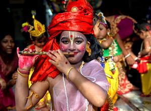Little children dressed up as Lord Krishna seen during the Janmastami festival in Kolkata. Janmastami is an annual Hindu festival that celebrates the birth of Krishna - incarnation of Vishnu as per Hindu mythology.