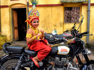 A little kid dressed up as Lord Krishna poses on a Motorcycle in front of the Krishna Temple in Kolkata. Janmastami is an annual Hindu festival that celebrates the birth of Krishna - incarnation of Vishnu as per Hindu mythology.