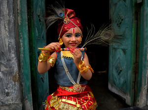 A little child seen dressed up as Lord Krishna seen during the Janmastami festival in Kolkata. Janmastami is an annual Hindu festival that celebrates the birth of Krishna - incarnation of Vishnu as per Hindu mythology.