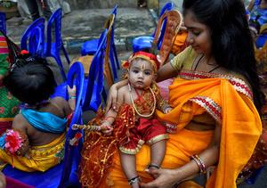 A little kid seen dressed up as Lord Krishna seen during the Janmastami festival at the Temple in kolkata. Janmastami is an annual Hindu festival that celebrates the birth of Krishna - incarnation of Vishnu as per Hindu mythology.