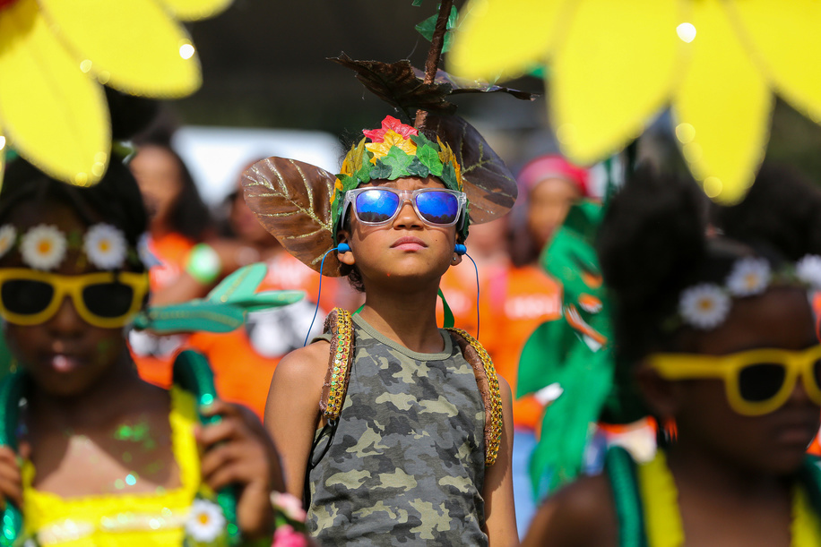 Kid dancer in a costume during the children parade on the family day of Notting Hill Carnival in west London. Thousands of revellers take part in Notting Hill Carnival, Europe's largest street party and a celebration of Caribbean traditions and the capital's cultural diversity.