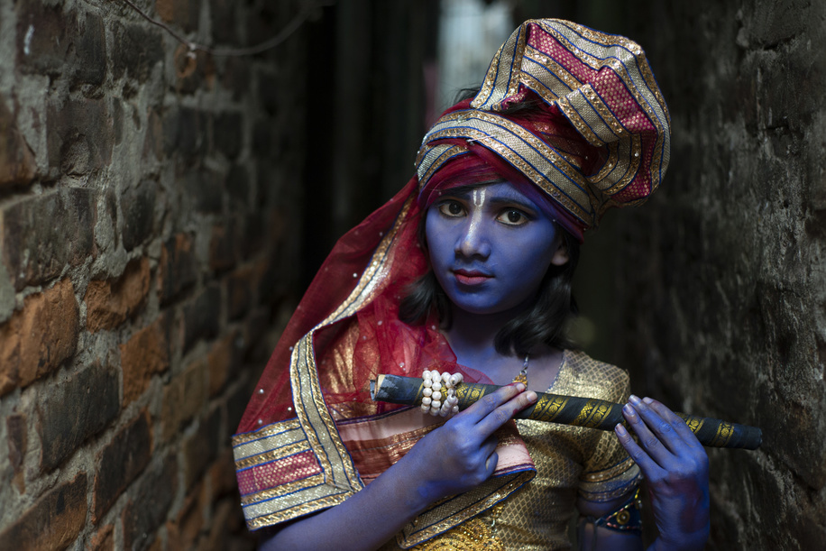 A young girl dressed as Krishna participate  during the occasion of Janmashtami. Followers of Hinduism put makeup and dressed as many characters from Ramayana in the occasion of Janmashtami, the birth anniversary of Lord Krishna and arrange rallies and gatherings of people of their community.