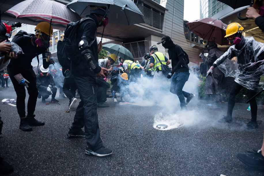 Protesters cover tear gas with aluminium bowls during the demonstration. Thousands of protesters again took the streets to oppose the controversial extradition bill. What started as a peaceful march ended in violence as police fired dozens of rounds of tear gas and various projectiles, while protesters hurled bricks and molotov cocktails.