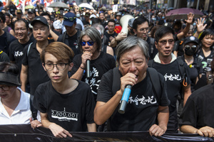 Hong Kong politician and social activist Lee Cheuk-yan marches with other politicians at the frontline of the rally. Thousands of anti-china protesters marched and clashed with police in Hong Kong as the party celebrates its 70th year of rule.