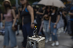 A miniature figure toy resembling a protester is being displayed during the rally. Thousands of anti-china protesters marched and clashed with police in Hong Kong as the party celebrates its 70th year of rule.
