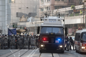 Riot police stand on guard in Sai Yin Pun while protecting Liaison Office during the protest. Thousands of anti-china protesters marched and clashed with police in Hong Kong as the party celebrates its 70th year of rule.