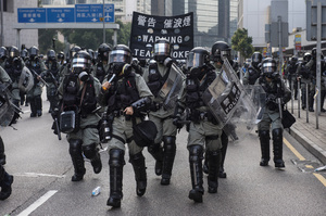 Riot police officers announce to the protesters that tear gas is imminent during the clashes. Thousands of anti-china protesters marched and clashed with police in Hong Kong as the party celebrates its 70th year of rule.