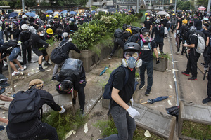 Anti-government protesters set barricades to block water cannon and riot police officers access during the protest. Thousands of anti-china protesters marched and clashed with police in Hong Kong as the party celebrates its 70th year of rule.