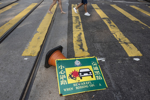 A vandalized street sign lies at the middle of the road in Sain Yin Pun, Hong Kong during the protest. Thousands of anti-china protesters marched and clashed with police in Hong Kong as the party celebrates its 70th year of rule.