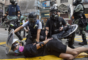 A protester is being arrested by the riot police officers after the clashes with the police. Thousands of anti-china protesters marched and clashed with police in Hong Kong as the party celebrates its 70th year of rule.