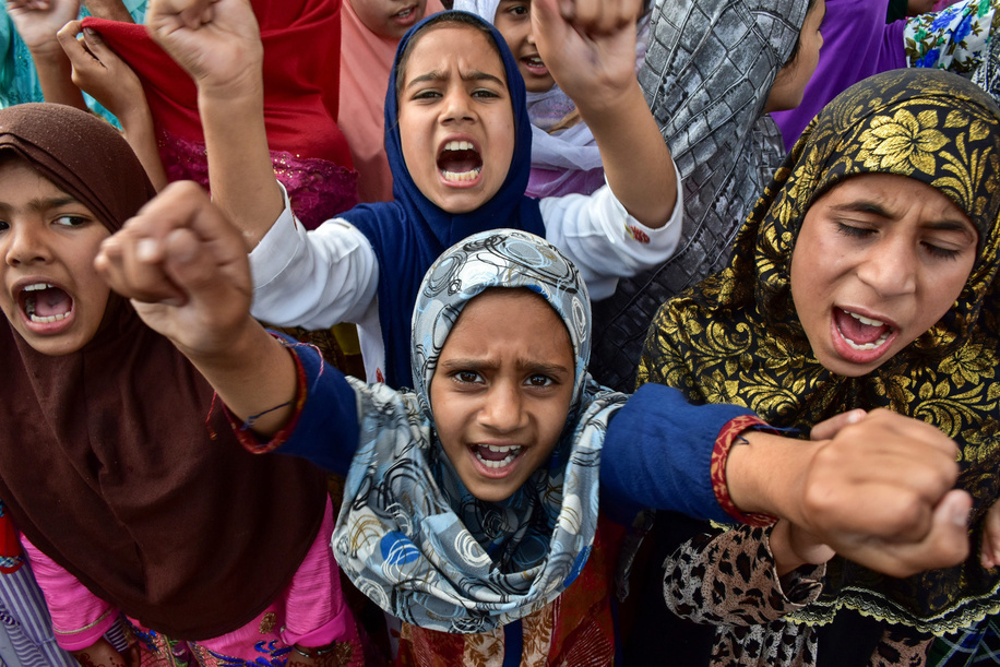 Kids chant slogans while making gestures during the protest. A rally was held in Srinagar city soon after the Friday prayers following the scrapping of Article 370 by the central government which grants special status to Jammu & Kashmir.