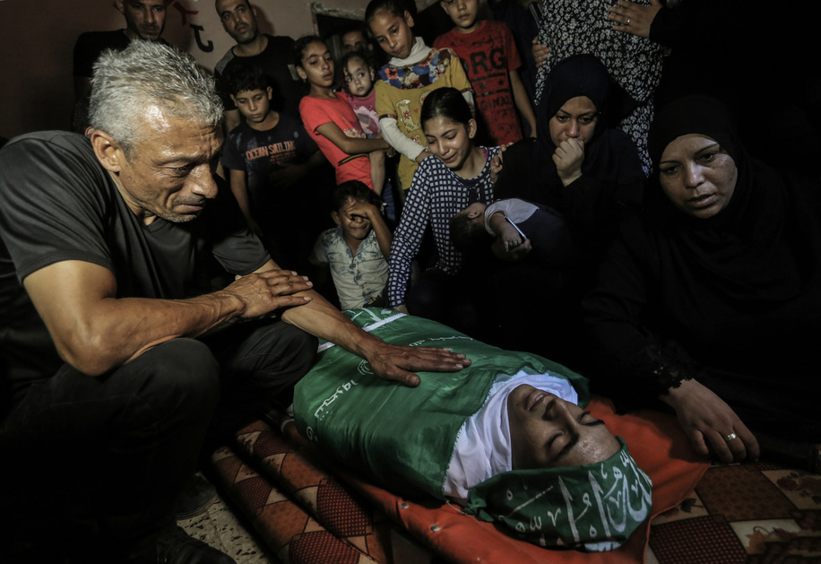 (EDITOR'S NOTE: Image depicts death.) Relatives mourn next to body of the deceased during the funeral procession in Rafah. Saher Othman, 20, a Palestinian was killed by Israeli fire during a demonstration calling for the lifting of years of siege on the Gaza Strip along the Gaza-Israel border fence on Friday.