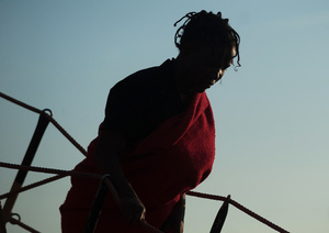 A sub-Saharan migrant woman disembarks from a rescue vessel on arrival at the Port of Malaga. A total of 61 migrants were rescued from a dinghy at the Mediterranean Sea by Spain's Maritime Rescue Service and brought them to Malaga harbor where they were assisted by the Spanish Red Cross.
