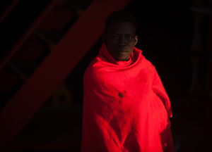 A sub-Saharan migrant covered with a red blanket in a rescue vessel on arrival at the Port of Malaga. A total of 61 migrants were rescued from a dinghy at the Mediterranean Sea by Spain's Maritime Rescue Service and brought them to Malaga harbor where they were assisted by the Spanish Red Cross.