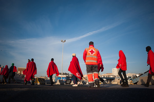 Sub-Saharan migrants walk toward a humanitarian emergency stall on arrival at the Port of Malaga. A total of 61 migrants were rescued from a dinghy at the Mediterranean Sea by Spain's Maritime Rescue Service and brought them to Malaga harbor where they were assisted by the Spanish Red Cross.