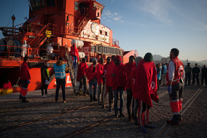 Sub-Saharan migrants disembark from a rescue vessel on arrival at the Port of Malaga. A total of 61 migrants were rescued from a dinghy at the Mediterranean Sea by Spain's Maritime Rescue Service and brought them to Malaga harbor where they were assisted by the Spanish Red Cross.